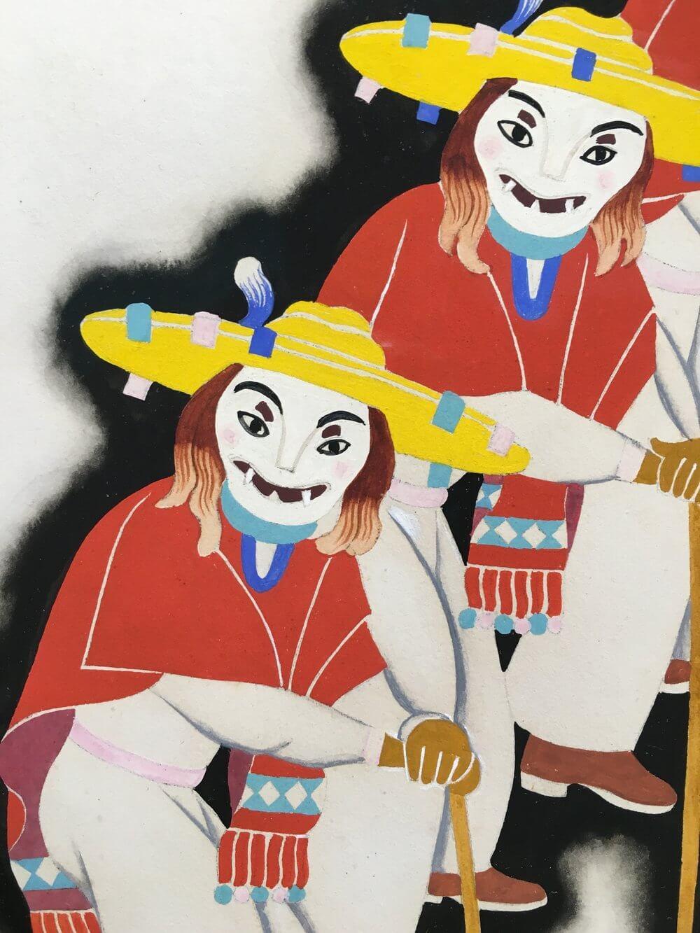 Obra de dos personas con máscara y trajes típicos