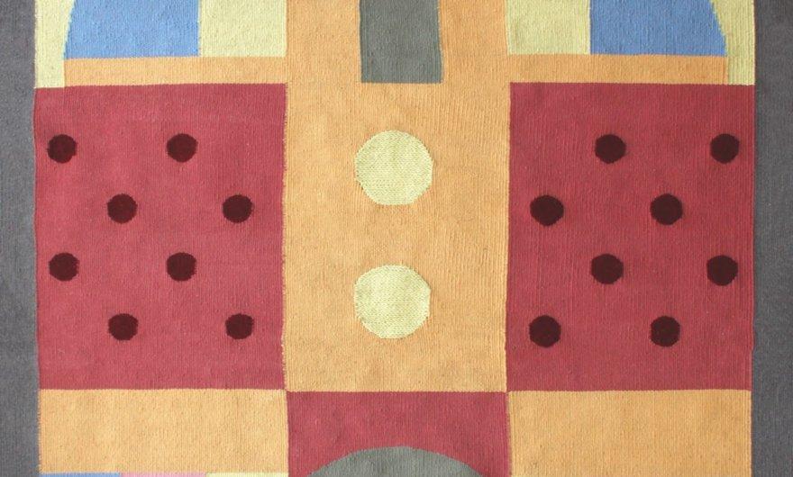 Tapiz de figuras geométricas confeccionada por Olk Manufactory