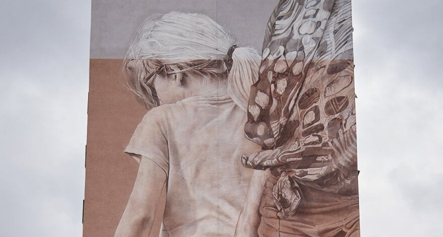 Guido van Helten creó dos murales en Łódź