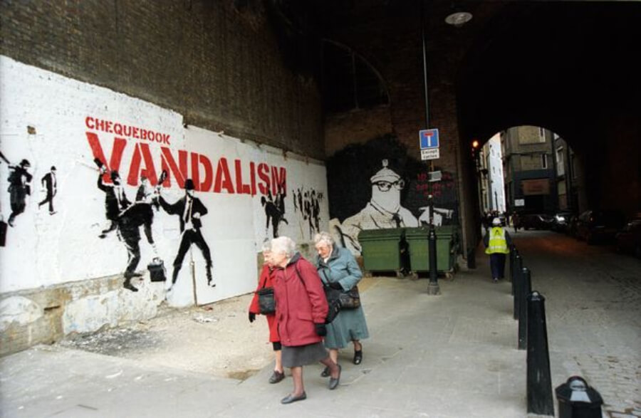 people watching Banksy's play