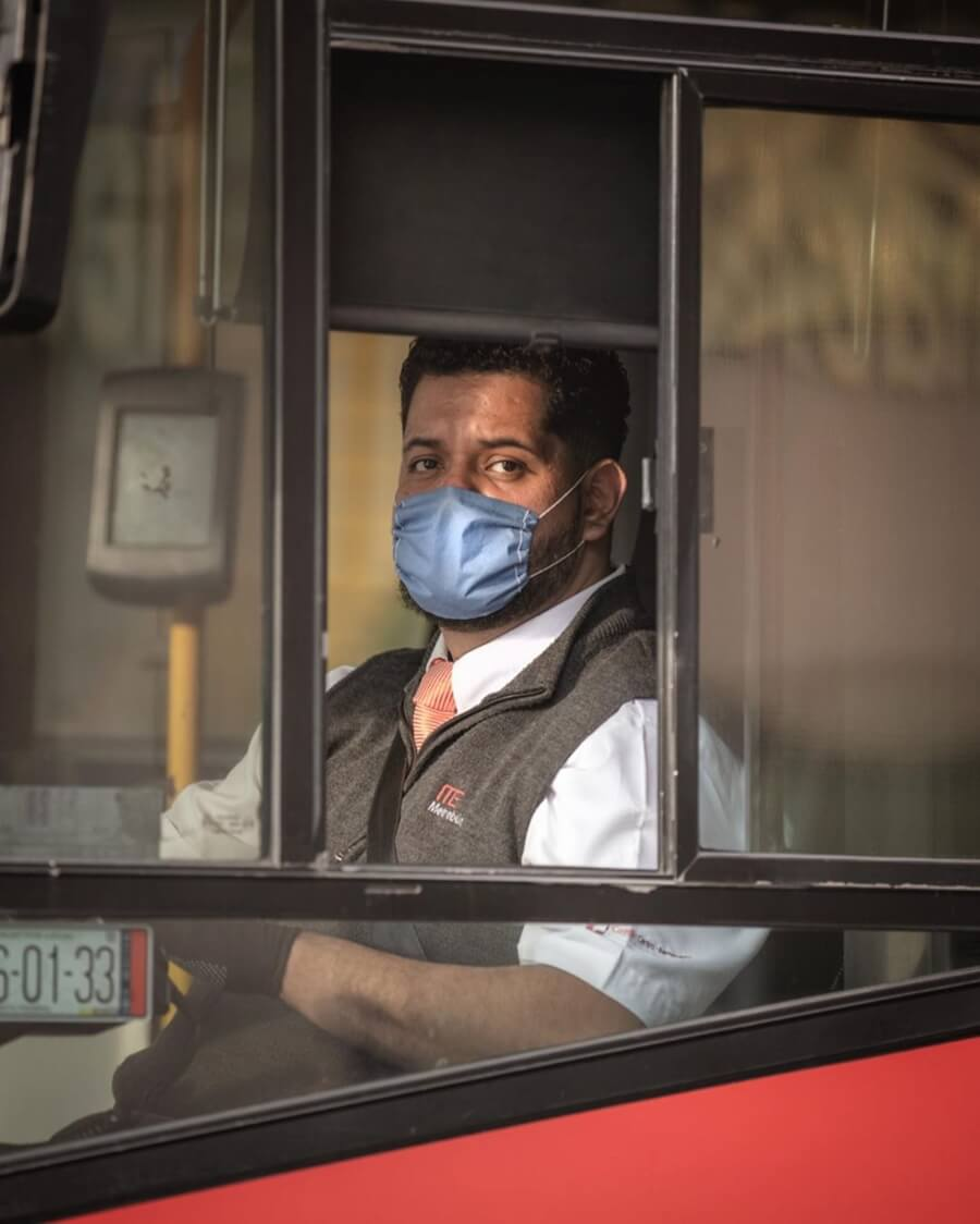 Coronavirus through Santiago Arau's lens / metrobus driver with face mask