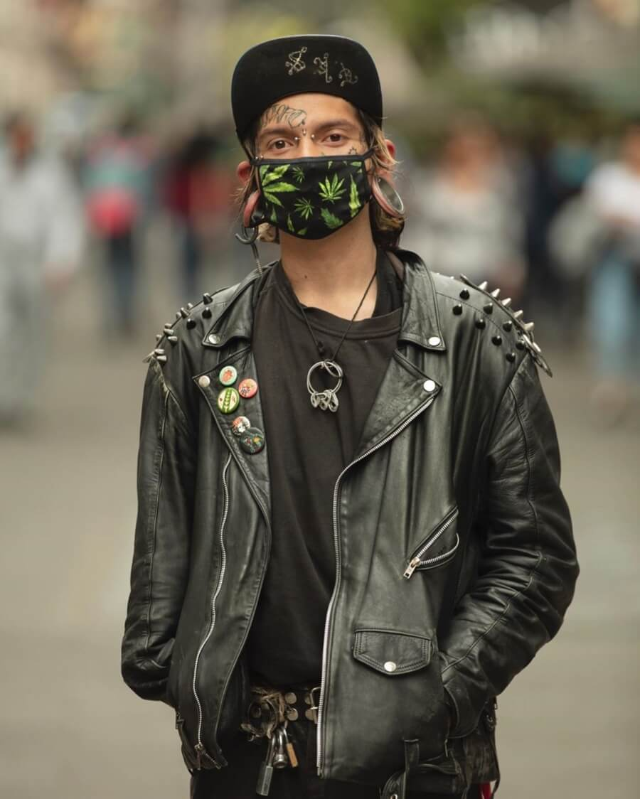 The Coronavirus through Santiago Arau's lens / young man with a black leather jacket and face mask
