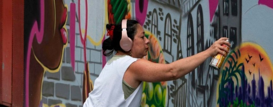 Women in graffiti boasting their female power