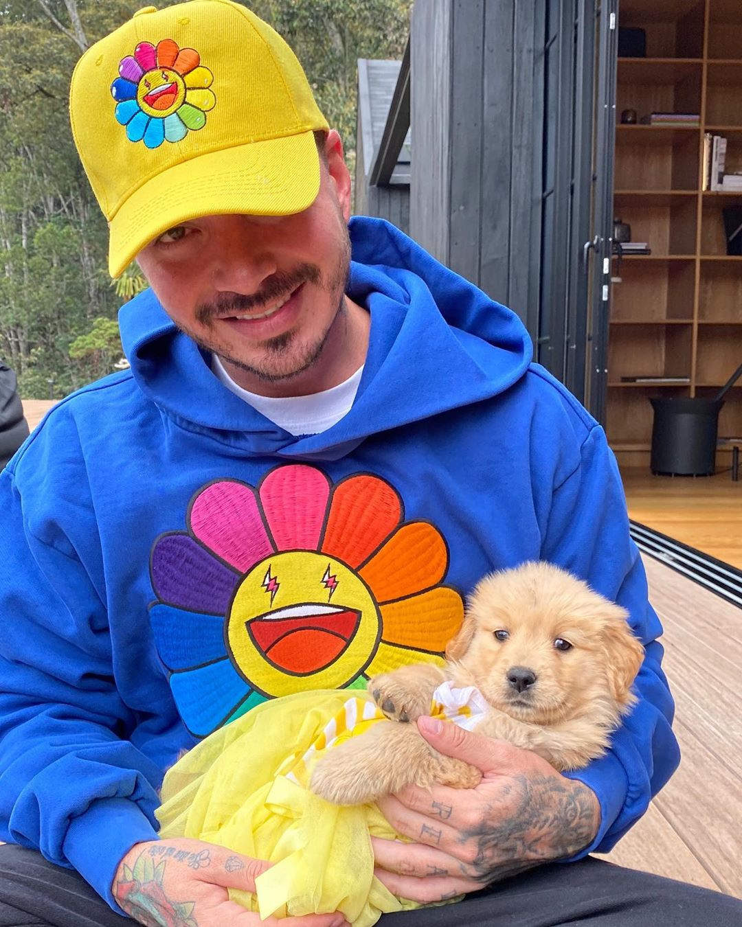 Photo of J Balvin and his dog
