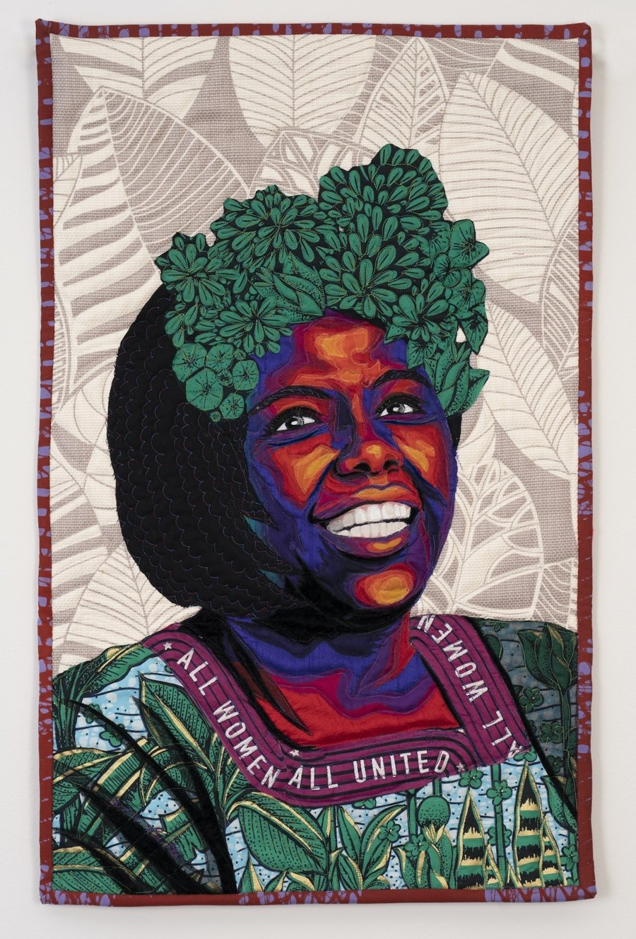 Obra textil con el retrato de mujer negra