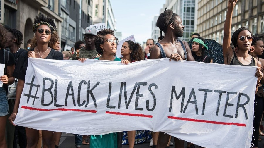 African-Americans protesting with Black Lives Matter banner