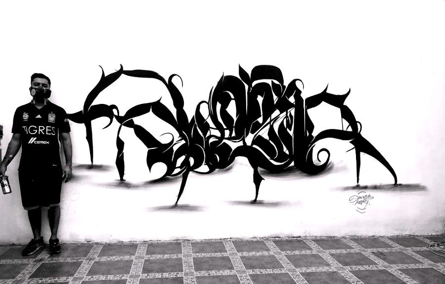 Araña hecha con caligrafía por Dones Mendoza