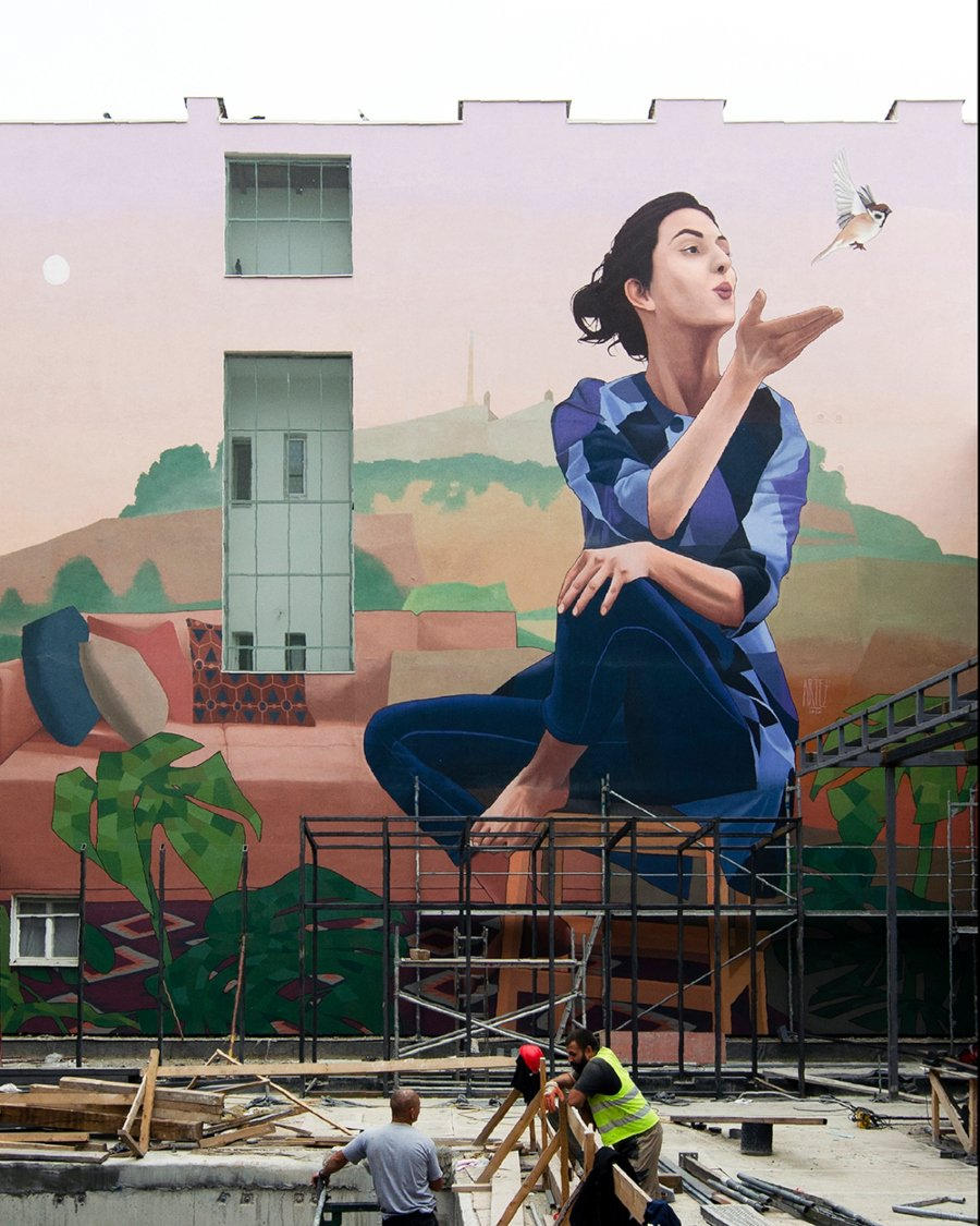 Woman with sparrow, part of Artez's latest mural