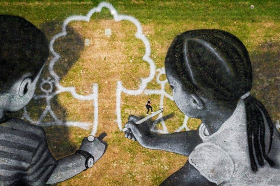 Dos niños dibujando el mundo ideal