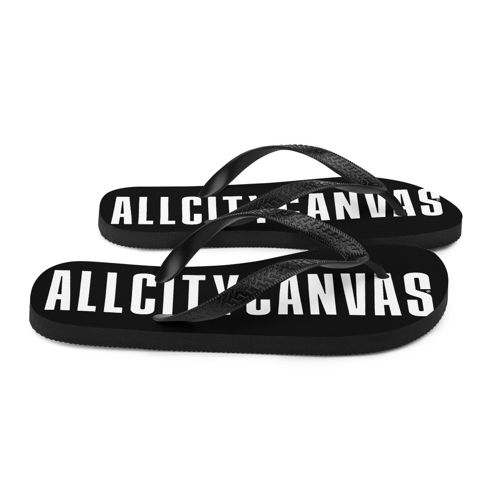 ACC black flip flops with white typography