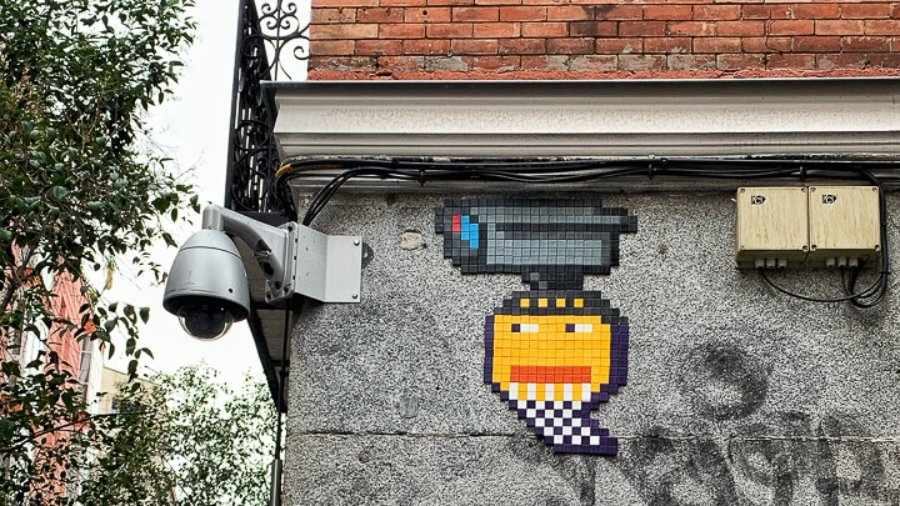 Basket of Nean mosaic piece with a yellow ball and security camera
