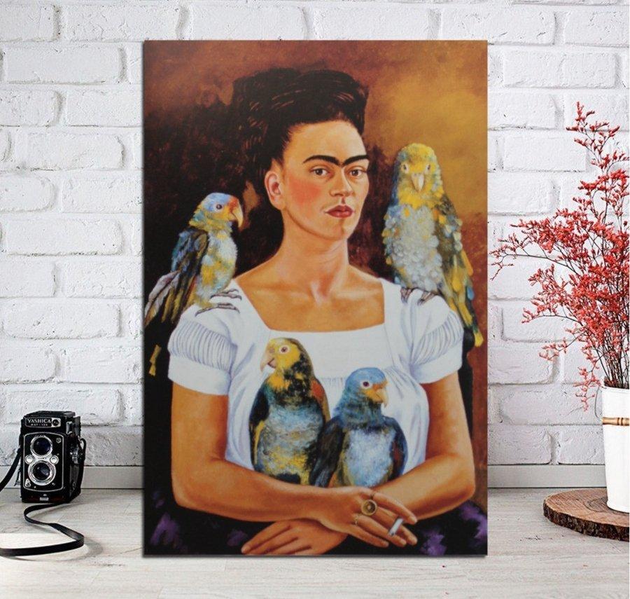"""Frida Khalo's painting """"Mis Pericos y Yo"""" on white brick background"""