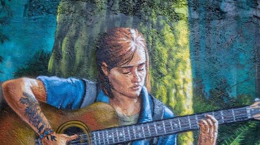 Mural de Metod que muestra a Ellie de The Last of Us part II tocando la guitarra debajo de un árbol en medio del bosque