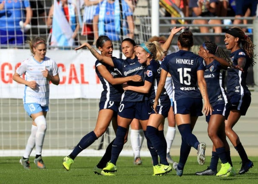 Debinha of the North Carolina Courage, pictured with her arms out, celebrated a goal with her teammates on Sunday in the N.W.S.L. title game.Credit...