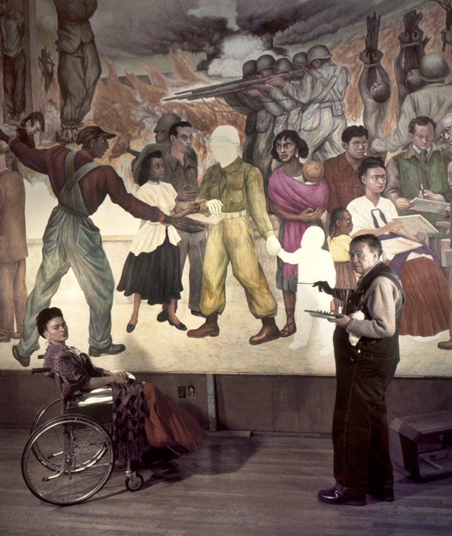Diego Rivera pintando y su lado Frida Khalo